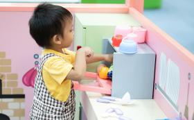 Small child playing in kitchen